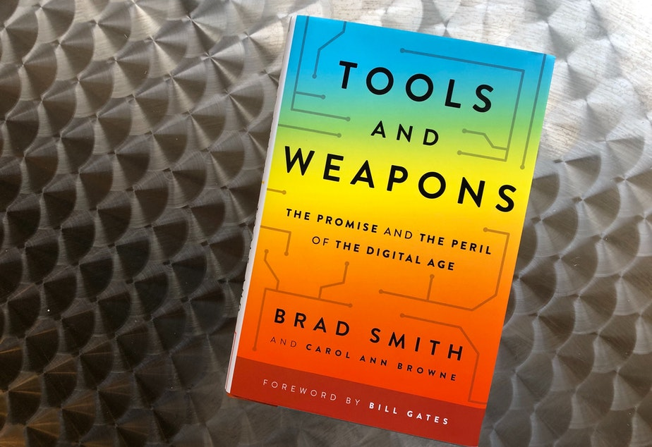 "caption: ""Tools and Weapons: The Promise and the Peril of the Digital Age"" by Brad Smith and Carol Ann Browne."