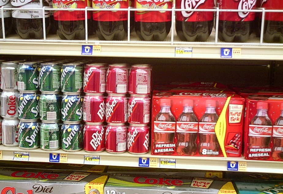 caption: Soda shelves at grocery store