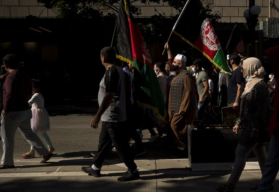 """caption: About 100 people attended a rally and march to stand in solidarity with Afghans on Saturday, August 28, 2021, at Westlake Park in Seattle. """"What is happening in Afghanistan is devastating,"""" said Shugla Kakar, with Afghans of Seattle. """"We're trying to amplify Afghan voices and experiences, and push for urgent action by our federal, state and local leaders to help evacuate those at grave risk in Afghanistan while also supporting the incoming Afghan refugees in our state."""""""