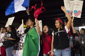 Suri Emigdio, 11, second from right, and Rocio Carranza, right, cheer during the annual March for Immigrant and Workers Rights on Tuesday, May 1, 2018, in Seattle. Tap or click on the first image to see more.