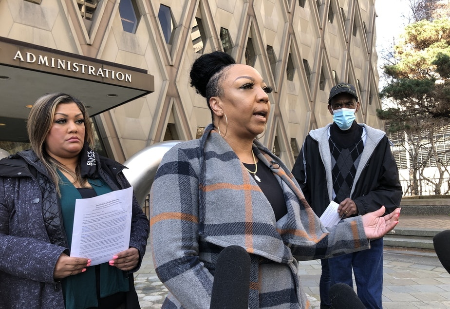 """caption: Alexis Francois, center, says KCSO discipline was too lenient for officer who referred to Black youth as """"animals"""" in a Facebook post."""