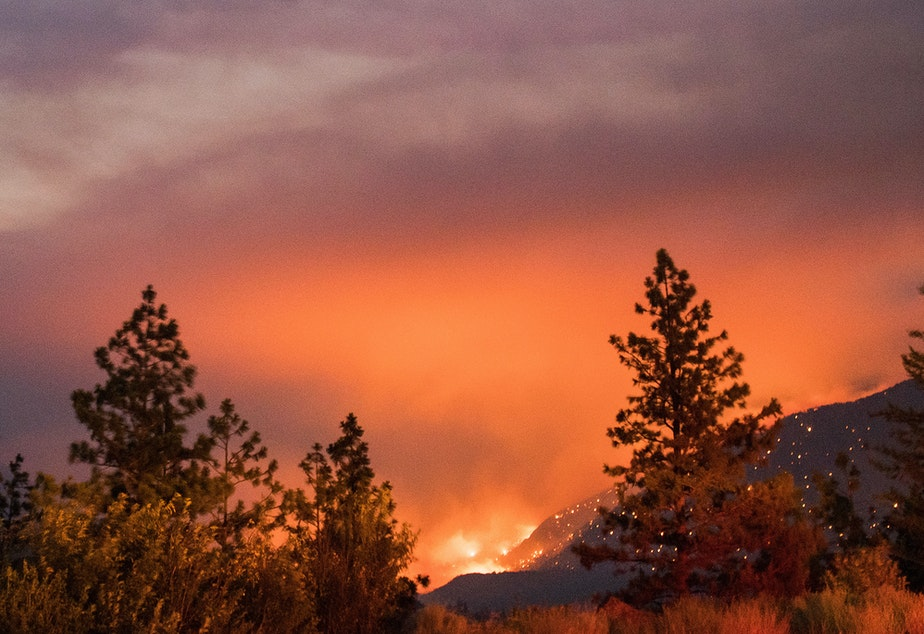 caption: Wildfire burns above the Fraser River Valley near Lytton, British Columbia, Canada, on Friday.