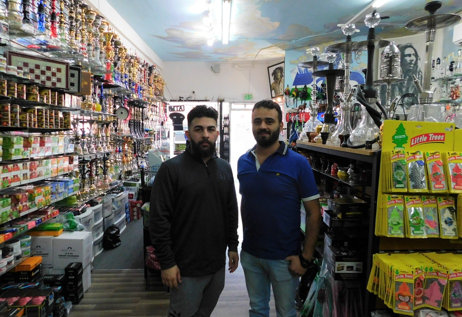 caption: Store Manager Ali P. and Shop Owner Yasir Shammar