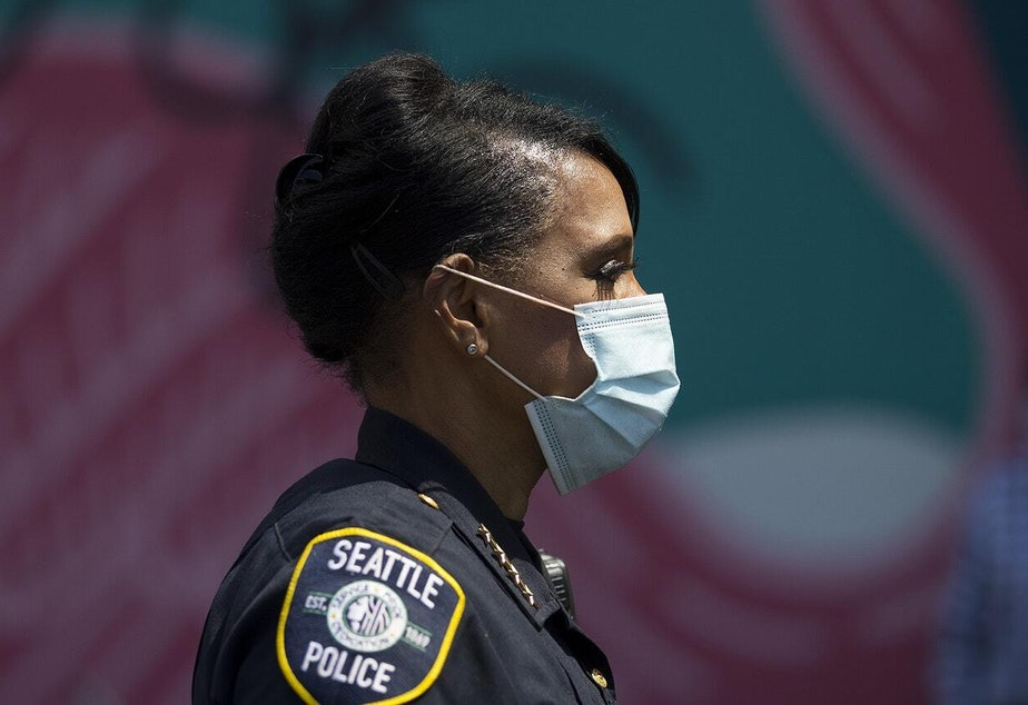 caption: Seattle Police Chief Carmen Best attends a vigil to recognize the senseless killing of African American men and women outside of the First African Methodist Episcopal Church on Monday, June 1, 2020, in Seattle