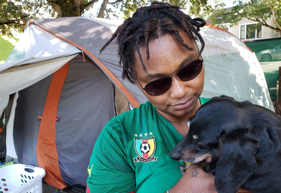 caption: Brooklyn Gardenshire and her dog, Taz,  at the Tent City 3 camp beside I-5 in Ravenna on Tuesday, August 27, 2019. Gardenshire has moved five times in the 10 months she's lived with Tent City 3. On September 7, she'll move again with the camp to a church in Tukwila.