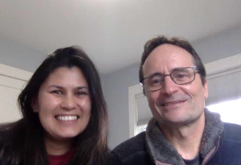 caption: Jim Mazza and Lizz Dexter-Mazza, at home and seen through their webcam. The two hold free, daily online classes for kids and parents on how to cope during Covid-19