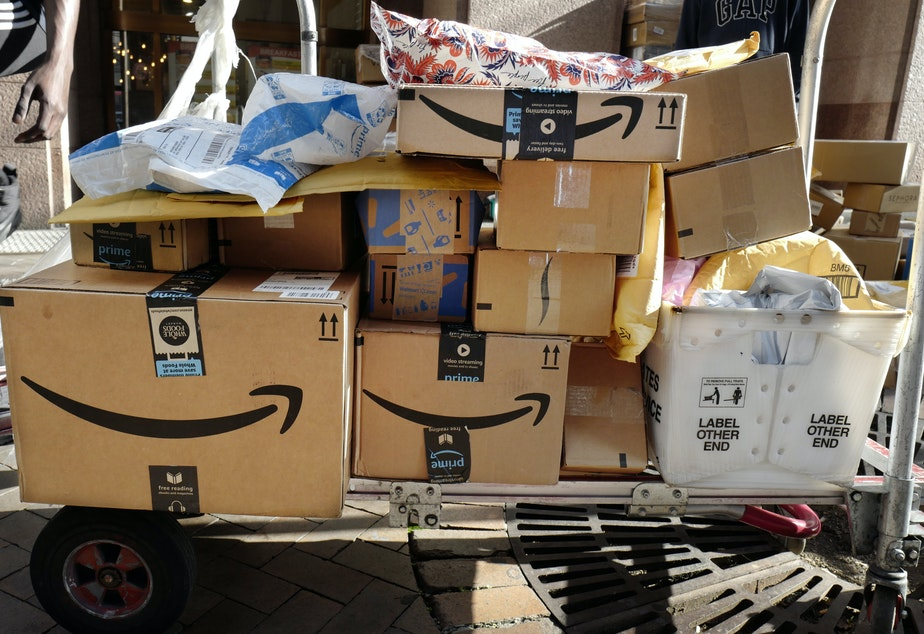 Amazon Prime packages are loaded on a cart for delivery in New York.