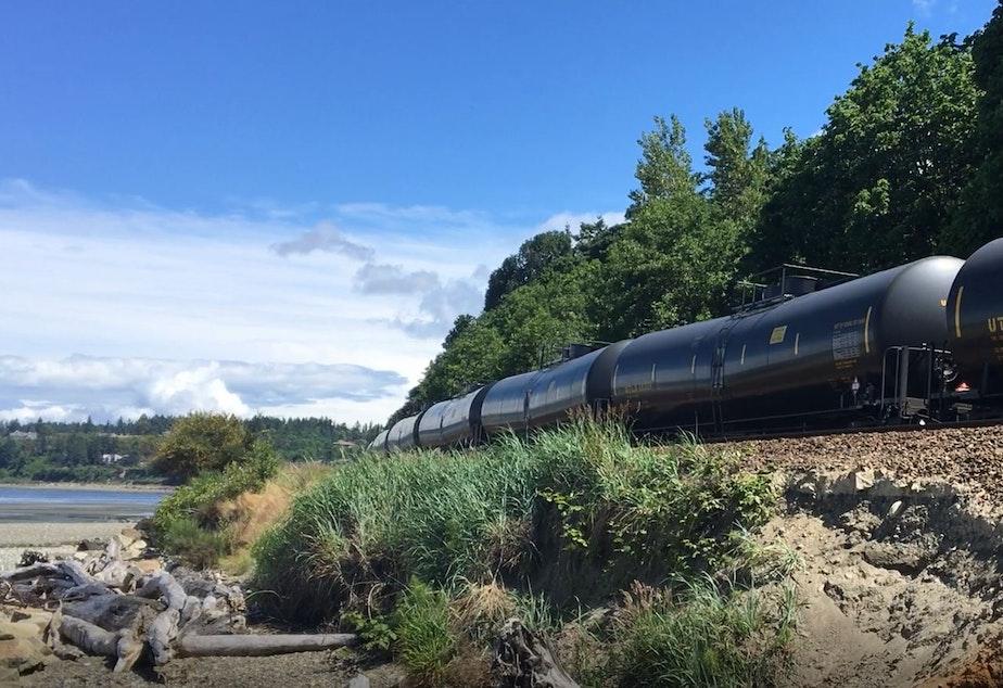 caption: An oil train rolls through Shoreline, Washington.