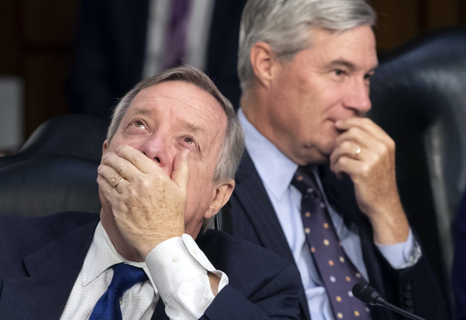 caption: Sen. Dick Durbin, D-Ill.(left), and Sen. Sheldon Whitehouse, D-R.I., are among nine Democratic members of the Senate Judiciary Committee who signed a letter accusing the Trump administration of politicizing the immigration courts.