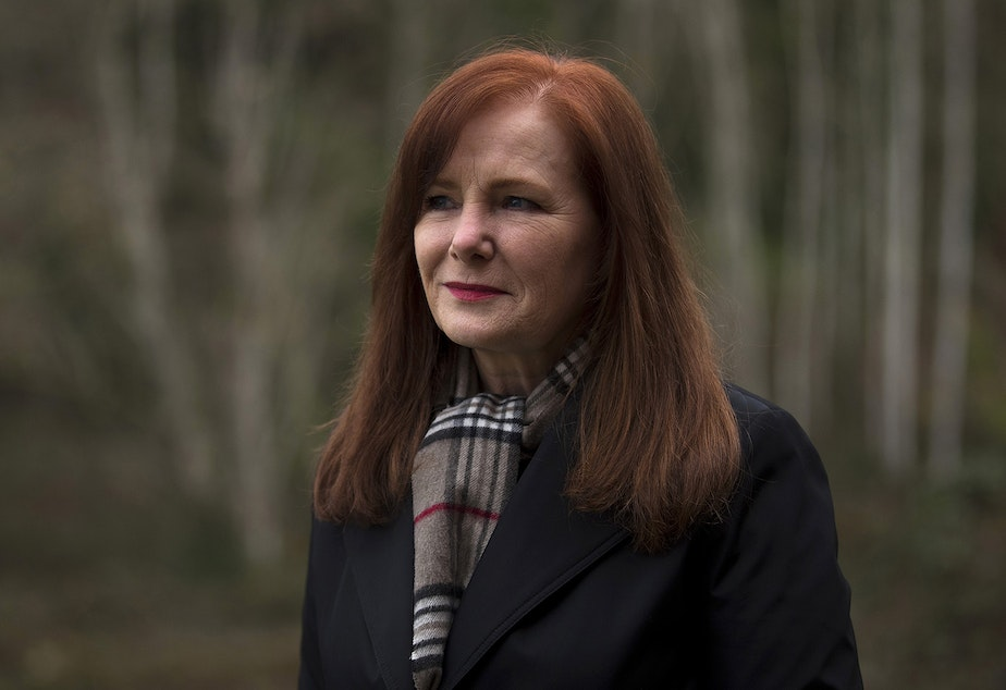 """caption: Susan Krikac stands for a portrait outside of her home on Wednesday, February 17, 2021, in Seattle. After testing positive in July, she is still experiencing various symptoms of Covid-19 today, seven months later. """"It was so isolating,"""" Krikac said of the experience at the beginning. """"You're just afraid every night that you're going to die in the middle of the night."""""""