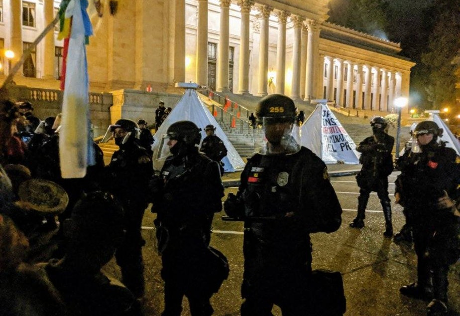 Police in riot gear moved on the protest the morning of September 25th, 2019 to clear out structures at the capitol steps. Indigenous climate activists are demanding Governor Jay Inslee declare a climate emergency.