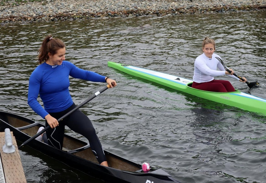 caption: Sprint canoeist Nevin Harrison, left, and kayak racer Anna McGrory head out for a workout in Seattle on May 21, 2021.