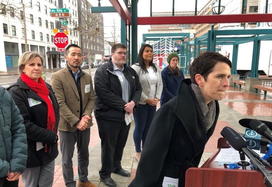 caption:  Deborah Jacobs, right, director of the King County Office of Law Enforcement Oversight, answers question at a press conference earlier this year.