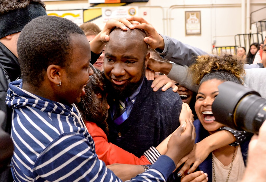 caption: Ecstatic students swarmed Nathan Gibbs-Bowling seconds after he heard Senator Patty Murray announce that he is the 2013–14 Milken Educator Award winner for the state of Washington.