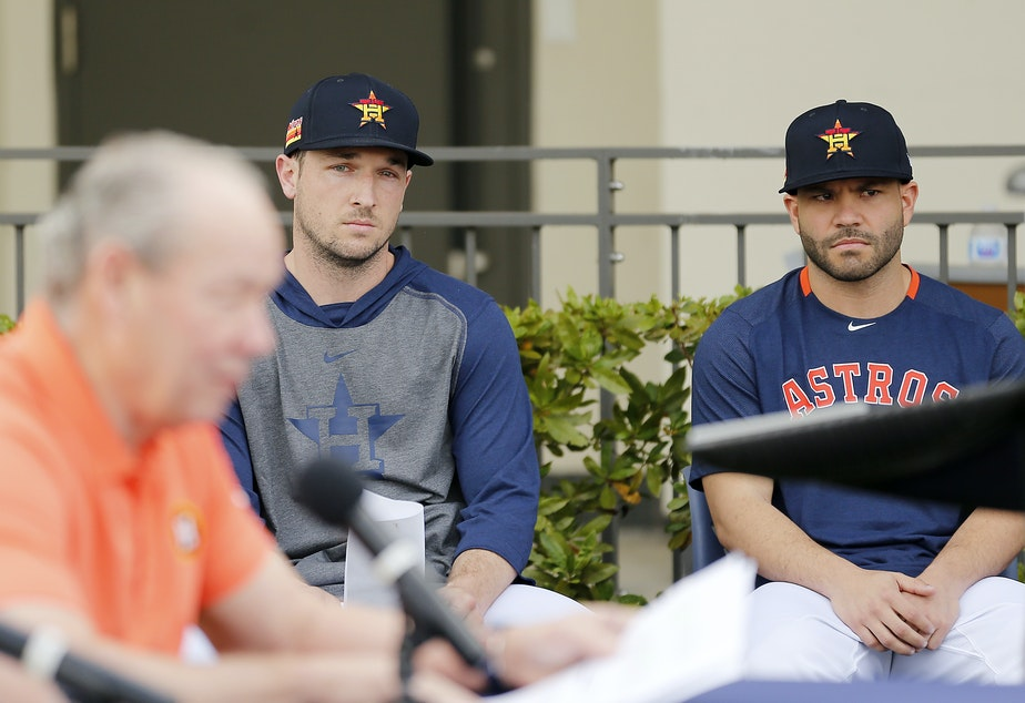 caption: Houston Astros players Alex Bregman and José Altuve looked on as owner Jim Crane addressed reporters during a news conference Thursday in West Palm Beach, Fla.