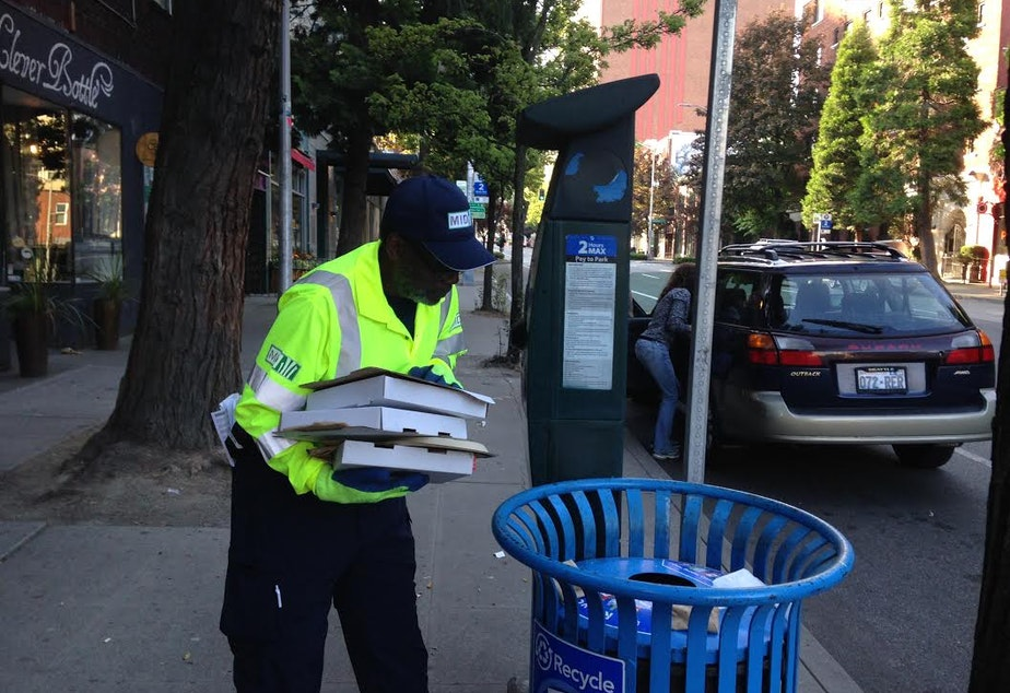"""caption: Lee Townsend with the Metroplitan Improvement District checks his """"hotspots"""" in Belltown for litter...and worse."""