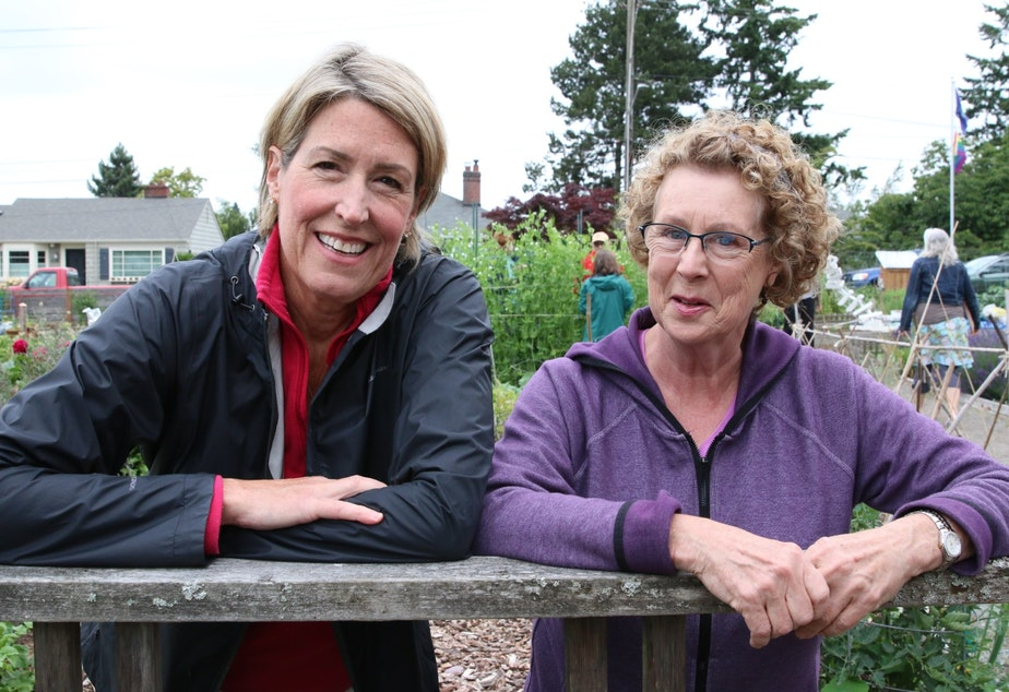 caption: Though on opposite sides of the issue, Pastor Kathy Hawkes and gardener Cindy Krueger have been brought closer together by the challenge to the Ballard P-patch. They both want the garden to remain. The trick is getting there.