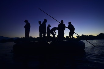Honduran migrants arrive at dawn Monday in Ciudad Hidalgo, in Mexico's far southwest. They used a makeshift raft to cross the Suchiate River, which forms part of the natural border between Guatemala and Mexico.