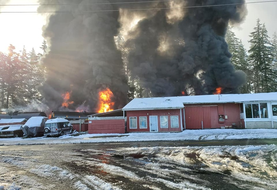 caption: A derailed oil train burns in the town of Custer, Washington, on Dec. 22.