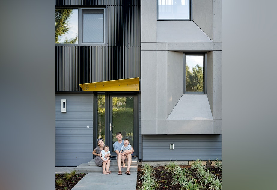 The Ritchie family - builder Sloan, wife Jennifer, Paxton and Sienna - outside Seattle's first Passive House