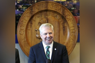 edb6a9ab5702 Seattle Mayor Ed Murray smiles as he addresses a news conference on a  proposal to increase
