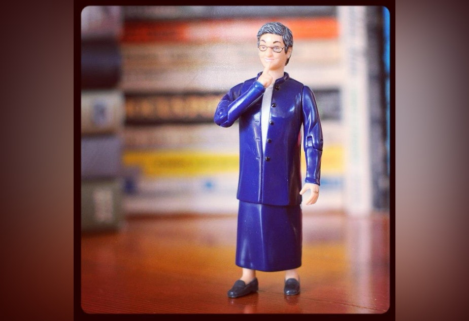 caption: Librarian Nancy Pearl action figure.