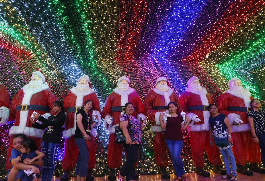 "Filipinos pose for souvenir shots at the ""Christmas House"" owned by businessman Alexander Cruz in suburban Cainta, Rizal province, Philippines, on Dec. 12, 2017. The whole house, decorated with hundreds of thousands of LED lights, has attracted local and foreign tourists."