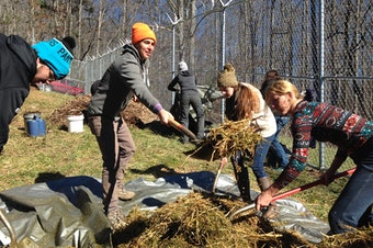 Katrina Spade (orange hat) of the Urban Death Project works with student volunteers to prepare a mulch pile at the Western Carolina University Forensic Osteology Research Center. (Tap on this image for more photos of the burial)