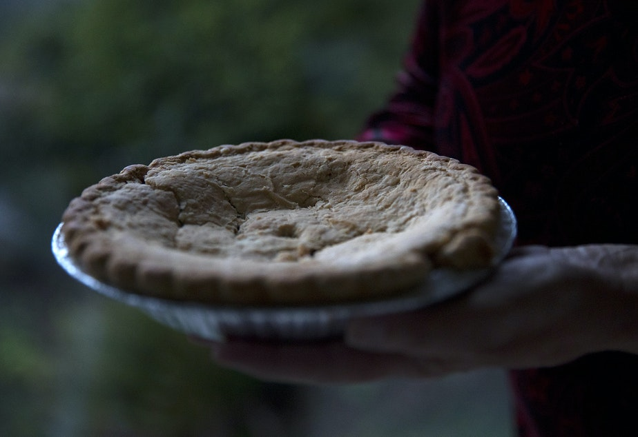 caption: Sheila Kelly holds a mincemeat pie bought by her mother, Helen May Kelly, in 1988, on Friday, November 22, 2019, at her home in Seattle. Her mother died before the pie could be consumed and she has kept it in her fridge for 31 years.