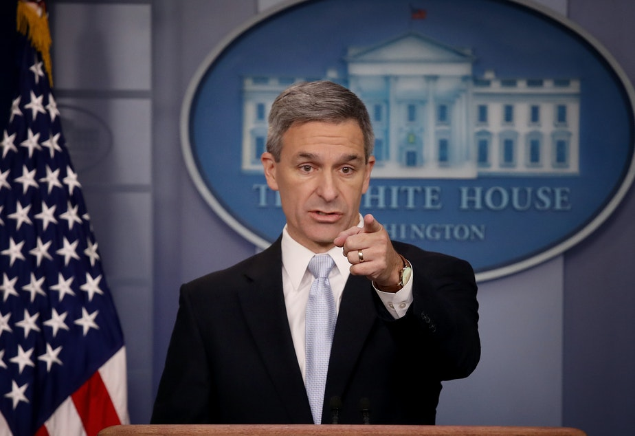 caption: Ken Cuccinelli, the acting director of U.S. Citizenship and Immigration Services, said Monday at the White House that immigrants legally in the U.S. may no longer be eligible for green cards if they use food stamps, Medicaid and other public benefits.