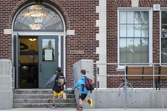 Two boys run towards Laurelhurst Elementary School on Friday, June 16, 2017, on NE 47th St., in Seattle, Washington.