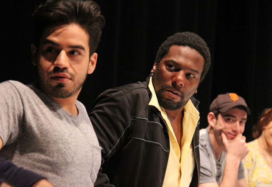 caption: Moises Castro, Reginald André Jackson, and Riley Shanahan in an Intiman workshop of 'John Baxter Is a Switch Hitter'  at the Intiman.