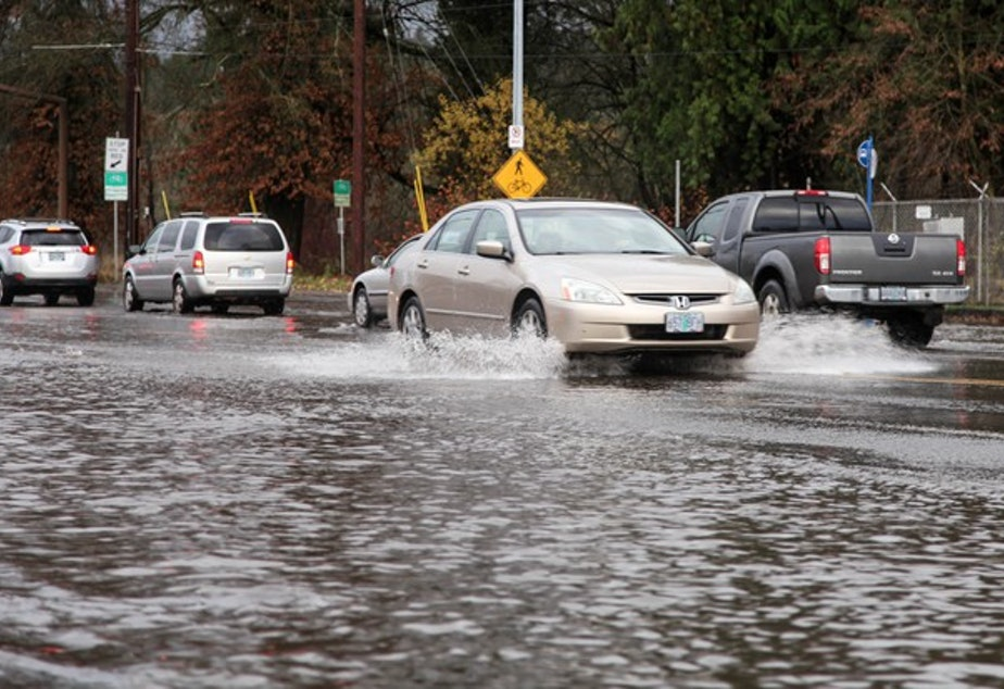 <p>In this Dec. 7, 2015, file photo, drivers wade through high waters after Johnson Creek in Southeast Portland flooded. The National Weather Service has issued a Flood Watch Northwest Oregon and Southwest Washington through Friday, Feb. 10, 2017.</p>