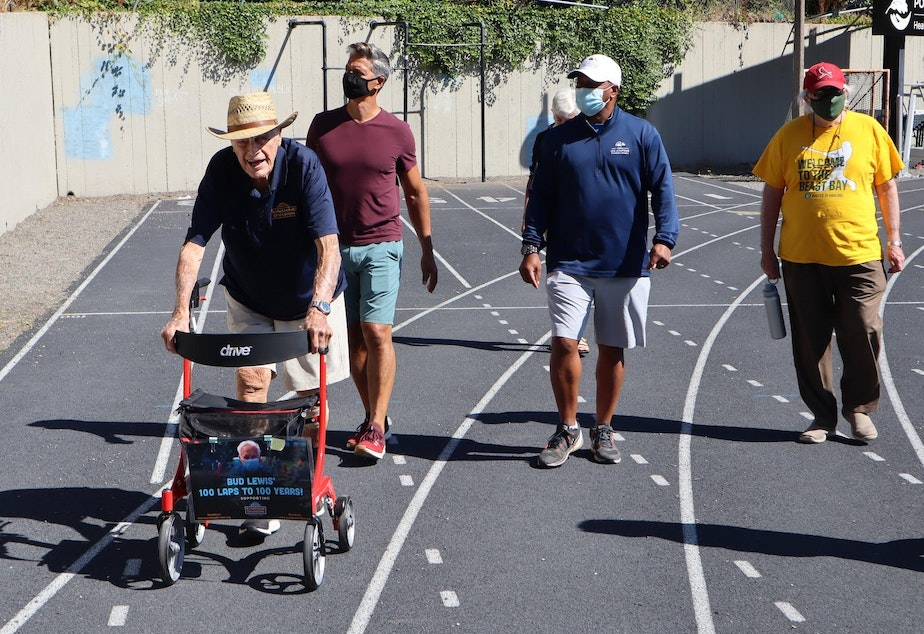 caption: World War II veteran Bud Lewis logged more laps of the Duniway Park track with supporters on Aug. 27, 2020.