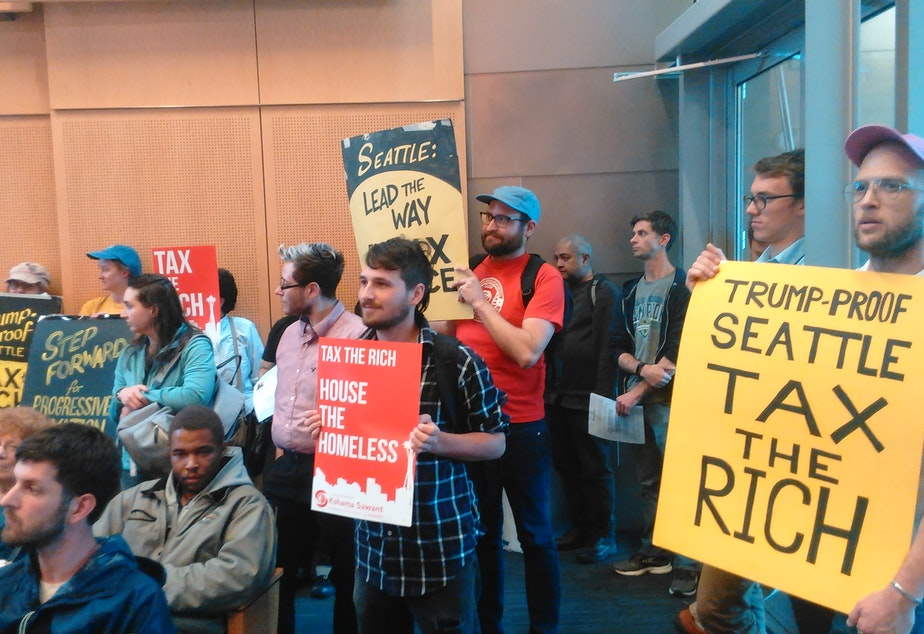 caption: People pack Seattle City Hall in June, 2017 for a meeting about whether to enact an income tax.