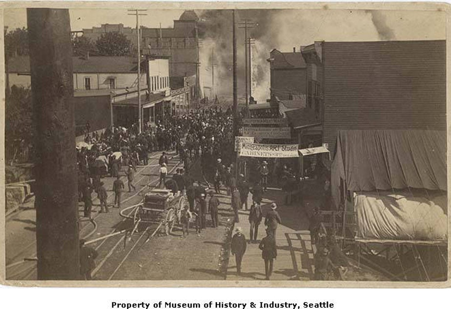 In this image crowds gather to watch the fire on Front Street (later First Avenue) at Union Street on June 6, 1889.