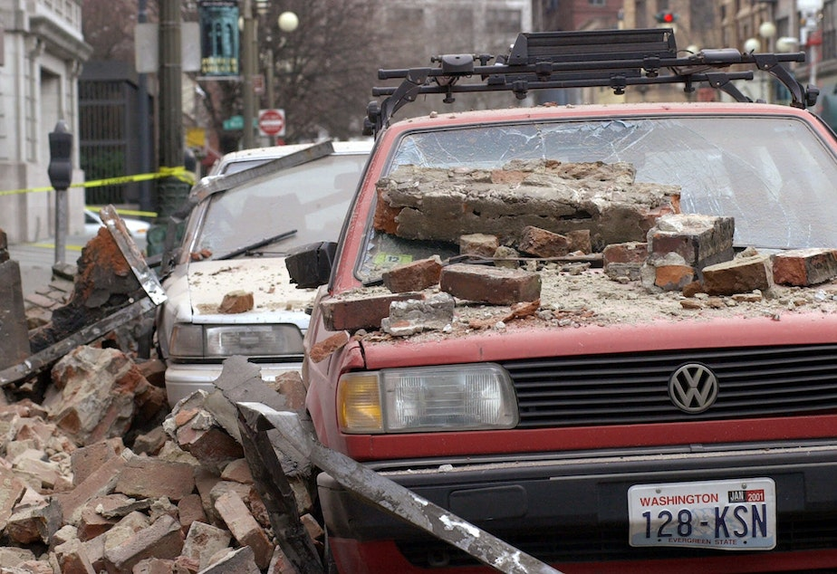 caption: Bricks that fell from the Nisqually earthquake cover parked cars in Seattle's Pioneer Square district, Wednesday, Feb. 28, 2001, in Seattle.