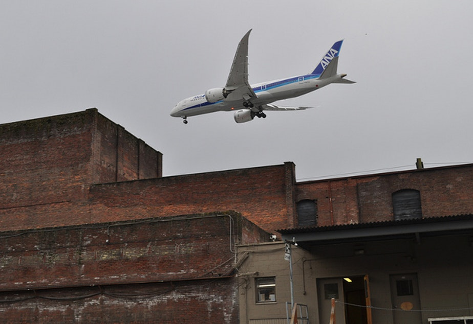 A low flying plane passes over Georgetown. Noise and local industrial pollution can sometimes give the area a bad rap.