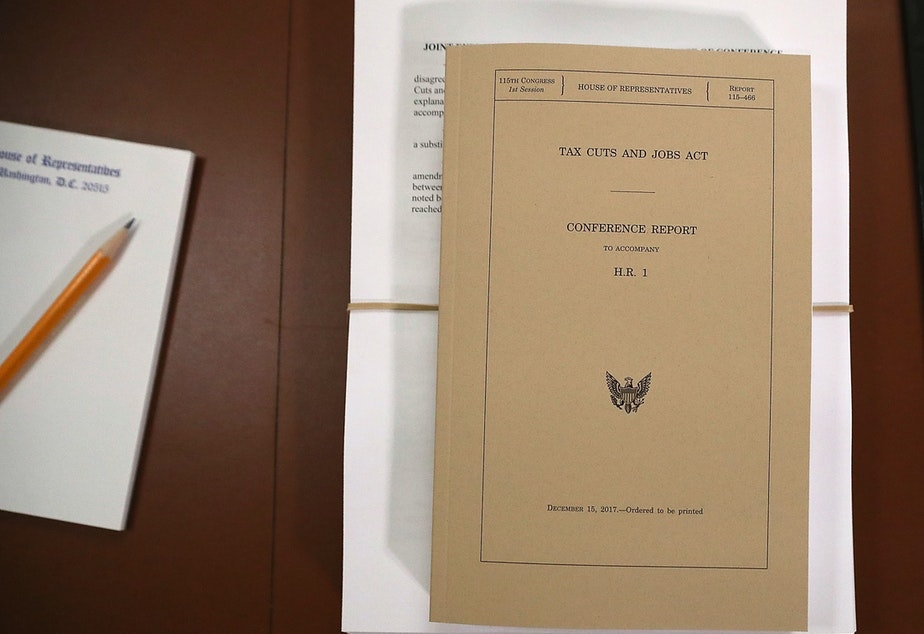 caption: A copy of the Tax Cuts and Jobs Act conference report sits at the U.S. Capitol on Dec. 18, 2017. The legislation was passed using the budget reconciliation process.