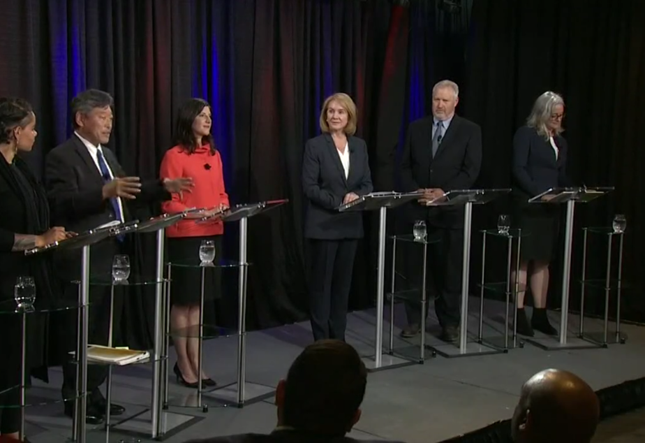 caption: Top candidates for Seattle mayor debate in a forum hosted by KING 5 and KUOW.
