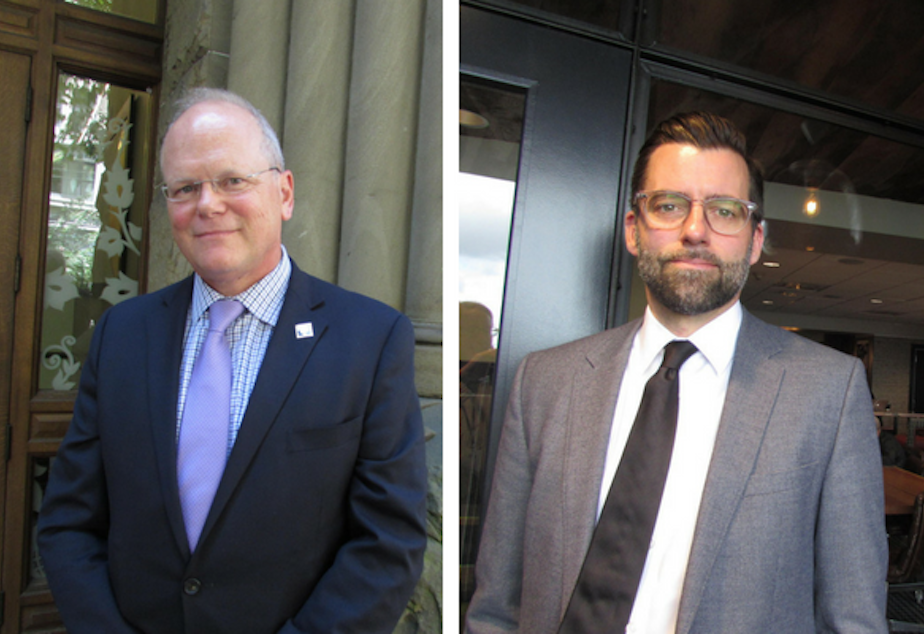 caption: Daron Morris (right) resigned as a public defender in King County to see the prosecutor's job in November to take on incumbent King County prosecutor Dan Satterberg (left).
