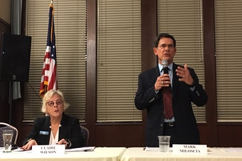 Republican state Senator Mark Miloscia speaks at a candidate's forum in Federal Way as his opponent Claire Wilson awaits her turn to respond.