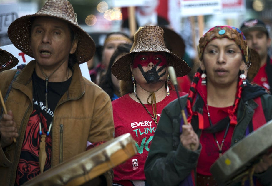 caption: Missing and Murdered Indigenous Women group members including Earth-Feather Sovereign, right, lead the march during the 'Cancel Kavanaugh - We Believe Survivors' march and rally on Thursday, October 4, 2018, in Seattle