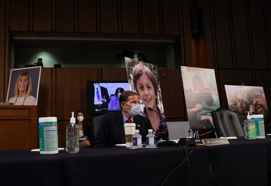 caption: Democrats on the Senate Judiciary Committee display photos of people who have been impacted by the Affordable Care Act, as the lawmakers argue that confirming Amy Coney Barrett to the Supreme Court would be detrimental to health care.
