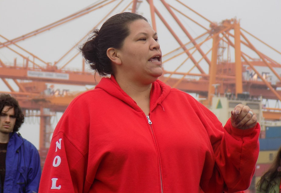 Puyallup Tribal Council member Anna Bean speaks at a protest against a liquid natural gas plant on the Tacoma waterfront.