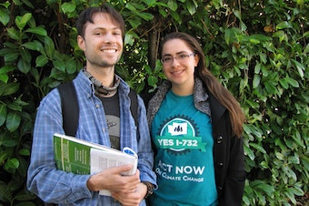 Ben Silesky, 26, and Sydney Allen, 21, go door to door to raise awareness and support for ballot Initiative 732, which would put a tax on carbon emissions in Washington.
