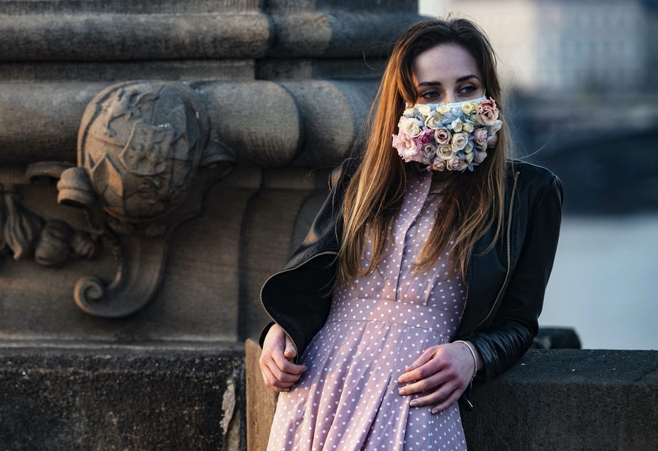 caption: A do-it-yourself mask culture is springing up in the Czech Republic. This woman was photographed on the Charles Bridge in Prague on March 28.