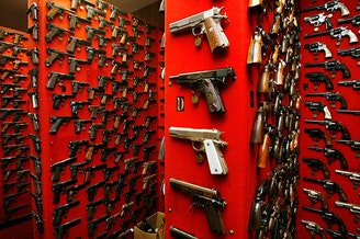 Guns line the walls of the firearms reference collection at the Washington Metropolitan Police Department headquarters in Washington, D.C.