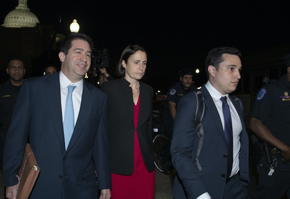caption: Former White House advisor on Russia Fiona Hill (center) leaves the Capitol on Monday after testifying before lawmakers as part of the House impeachment inquiry into President Trump.