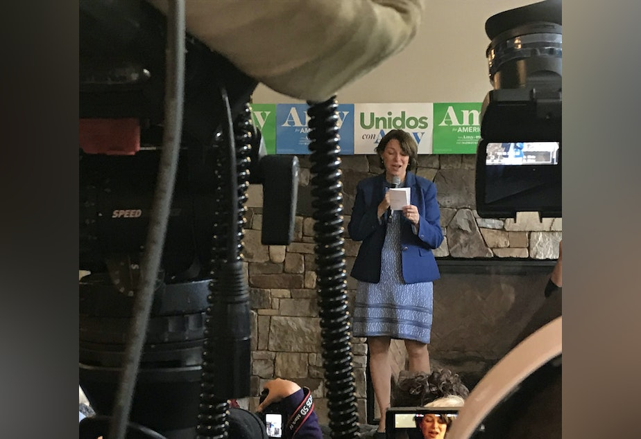caption: Senator Amy Klobuchar campaigns at Zoka Coffee Roaster & Tea Co in Northeast Seattle